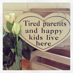 Hanging heart wooden sign- tired patents and happy kids live here Approx 27x20cm In cream and black We all know this