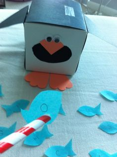 Penguin Fish Feed Game...could use tongs and pie cleaners for fine motor practice too!