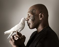 fuckyeahpigeon: Another peaceful portrait of Mike Tyson with a pigeon friend.
