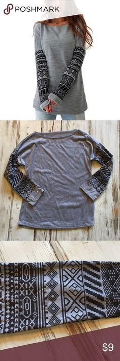 Gray long sleeve shirt size small New with out tags boutique shirt. This is a size small per the manufacturer, although there is no tag stating size. This is true to size. Fun prints on the sleeve and a raw neck hem line. Perfect for lounging around or casual days out! boutique Tops Tees - Long Sleeve