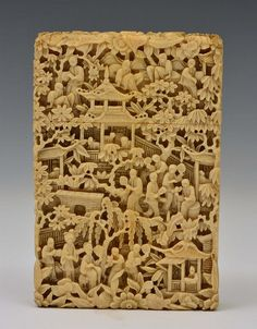 A CHINESE CANTON IVORY CARD CASE finely carved and undercut with figures, pavilions and pagoda style architecture amidst trees and foliage, 19th Century, 11.25cm x 7.25cm