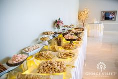 Traditional Pittsburgh wedding cookie table with cake in the background