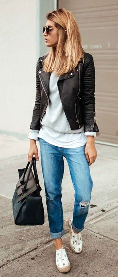 Trendy blonde in black leather jacket and boyfriend jeans