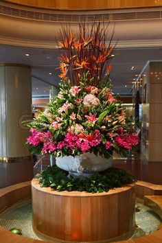 Huge magnificent flower bed - a vase decorate a hall of expensive hotel   Stock Photo   Colourbox on Colourbox