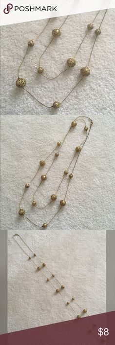 """Long golden necklace Golden chain with two sizes of decorative golden balls. Approximately 48.5"""" long. Wear as a single or double layer! Some tarnishing on the chain by the clasp. No trades, no PayPal. Jewelry Necklaces"""