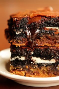 These dangerously decadent chocolate chip cookie 'n brownie bars combine the best of a gooey chocolate chip cookie, warm fudgy brownie, and an extra sweet double stuffed Oreo.
