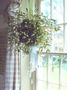 Like this but bigger - a mistletoe kissing ball to hang above the Church door, with fairy lights too.