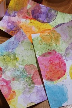 dishwashing soap, water, acrylic paint.  blow bubbles in cup, place paper over top to let bubbles pop onto paper.
