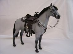 Custom Breyer model horse with western tack and mohair mane and tail.  Old-school work.