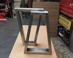 Modern Steel Tubing legs. Load up to 1000 lbs. on this set of 2 legs. This listing is for set of 2 Steel Tubing X Legs. - Made from Steel Tubing - 3 x 1 x 14 ga wall and 1/4 x 5 Flat bar on top - Legs are predrilled. - Finish - Raw steel, Clear coated, Black flat.