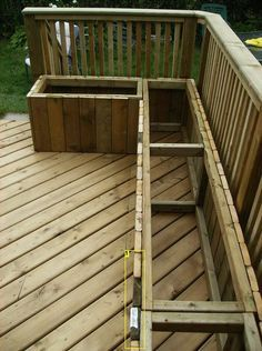 Building a wooden deck over a concrete slab. We need to do this over the small patio off of the living room. Dj could do raised garden beds or seating along one side...?