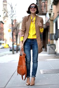 The bright pop of color under this gorgeous collarless jacket, boyfriend jeans, and pointed toe heels creates such a classic outfit