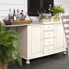 4-drawer flip-top bar with a pull-out serving tray and built-in wine rack.