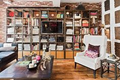 Large open bookshelves outline this dreamy home