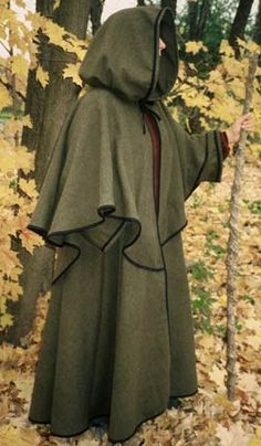 Guardian.  The ultimate winter cape with all the bells and whistles. Ties closed, all edges are finished in poly/cotton bias. In addition to the ultra warm over cape, this cape has sleeves and hidden pockets. Generously cut through sleeves, body and hood, and wide enough to cover any of our costumes, hoops and all. Dry clean.
