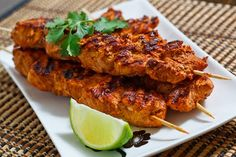 Grilled Tandoori Chicken(makes 4 servings) 1/2 cup plain yogurt  1/2 lemon (juice)  1/2 small onion (grated)  1 tablespoon garlic (grated)  1 tablespoon ginger (grated)  1 tablespoon garam masala  1 tablespoon paprika (I used hot smoked)  1 teaspoon cumin (toasted and ground)  1 teaspoon coriander (toasted and ground)  1/2 teaspoon ceyenne pepper (or to taste)  salt to taste  1 pound chicken (boneless and skinless,
