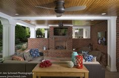#patio #covered patio #ceiling fan #outdoor fan #fireplace #wood burning fireplace #wicker seating #pillows #pillows