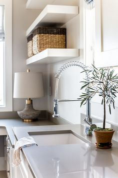 I love how simple and clean the grey quartz countertop looks with the undermount sink. Faucet is from MR Direct.