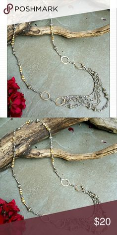 Freshwater Pearls and Metal necklace Gold colored freshwater pearls silver metal beads and hammered rings hold four sands of chain and beads. Jewelry Necklaces
