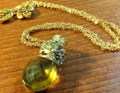 Olive quartz pendant with gold twisted chain and accents of citrine, peridot, gold, and silver. $120.00, via Etsy.