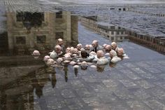 """Fantastic sculpture by Issac Cordal in Berlin called """"Politicians discussing global warming."""" from twitter post by Rachel Harger"""