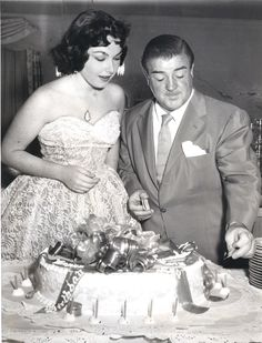 Lou Costello with his daughter Carole at her Sweet 16 party in 1954.