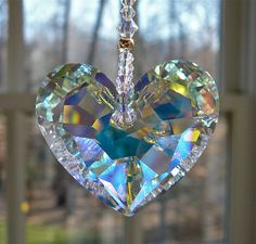 Hey, I found this really awesome Etsy listing at https://www.etsy.com/listing/123016616/swarovski-crystal-heart-sun-catcher