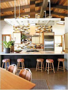 kitchens-blue-brown-orange-vaulted-ceilings-chandeliers-concrete-floors-counter-stools