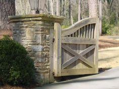An example driveway gate - photos taken around Atlanta Farm Gate, Fence Gate, Fencing, Front Gates, Entrance Gates, Driveway Landscaping, Outdoor Landscaping, Gate Post, Stone Driveway