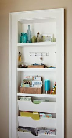 Kitchen organization ideas. This recessed shelf makes a great command center with space to hang keys, file mail, and keep magazines together.