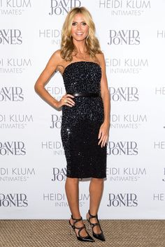 To celebrate her lingerie line in Australia, Heidi chooses a sparkly, strapless dress, which she coordinates with equally sparkly, strappy Sergio Rossi pumps.