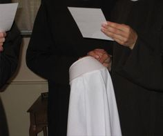 Before an older novice places the veil on the recently invested postulant, she recites with her a prayer for purity. The postulant then kisses it and it is placed upon her headfor the first time.