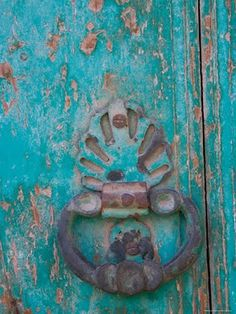Distressed turquoise door, ornate metal knocker