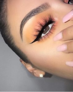Simple colorful eye makeup for hazel brown eyes. Winged liner and fluffy eye lashes.