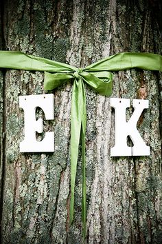 A silk ribbon bow and set of your and your groom's first initials is a charming way to dress up any tree.