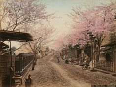 "Artist unknown: ""View of a Road with Wooden Houses on the Hill of Noge, near Yokohama"", circa 1900 