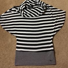Guess Cowl Neck Top Thin light weight sweater. Cowl neck. Strips are black and white. Open sleeves for comfort. Above elbow sleeves. Great with leggings. Guess Tops