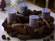 Adventskranz with pine cones - Reminds me of my mom's large pine cone wreath with almonds, pecans and walnuts on it that she hung on the wall every year.
