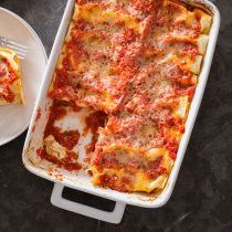 Manicotti may look homey, but blanching and stuffing pasta tubes is a tedious chore, and the ricotta filling can be uninspired and watery. We wanted a simpler, better recipe.