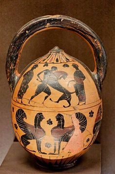 Heracles and the Nemean Lion. Side A from an Attic or Boeotian black-figure strainer-vase (sponge-holder), ca. 530–520 BC.