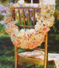 extravagant flower arrangement~ chair backs~ wedding