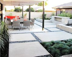 Modern patio design with concrete slabs and pebbles