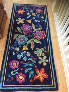 Primitive rug design in bright colors.