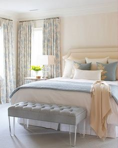 Blue white and cream bedroom with bench