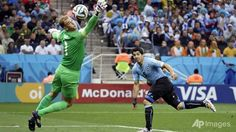 Uruguay beats England 2-1 at the World Cup in Sao Paulo