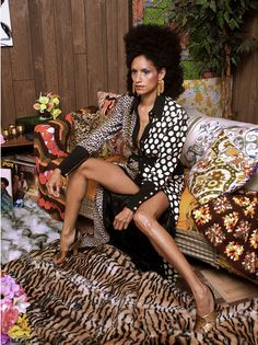 Even though the outcome of Mickalene Thomas' artistic practice tends to be large-scale paintings encrusted with rhinestones, along the way she is known to take photographs of her subjects as part of that process. Those photographs are now the subje...
