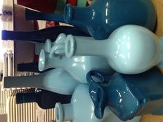 Turquoise and slate blue painted bottles... Perfect way too add decor... Rent for $1.00  to $3.00