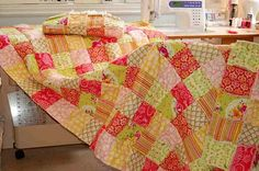 so close- watermelons, coral and sunshine colors..brighter version of Daylee's South Dakota quilt