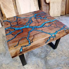 """""""Create a One of a kind! Fractal River Coffee Table in Walnut or Maple **Shipping will cost less for the smaller tables, contact me for a discount coupon before purchase. Hand crafted using a solid dark walnut or maple live edge slab, this table will be prepped and cut out by hand, fractal burned with 15,000 Volts, filled in with colored \""""two tone\"""" epoxy, and sanded & finished with care. -Choose your color for the epoxy river! If you don't see the color you would like, just message me and Epoxy Wood Table, Epoxy Resin Table, Slab Table, Walnut Dining Table, Diy Resin River Table, Resin Patio, Timber Table, Wood Table Design, Square Tables"""