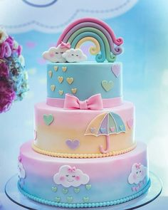 A rainbow cake is fun to look at and eat and a lot easier to make than you might think. Here's a step-by-step guide for how to make a rainbow birthday cake. Baby Cakes, Baby Shower Cakes, Cloud Baby Shower Theme, Baby Shower Cake Decorations, Cloud Cake, Rainbow Baby, Cake Rainbow, Unicorn Rainbow Cake, Rainbow Pastel
